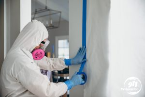 mold removal technician sectioning off rooms in residence